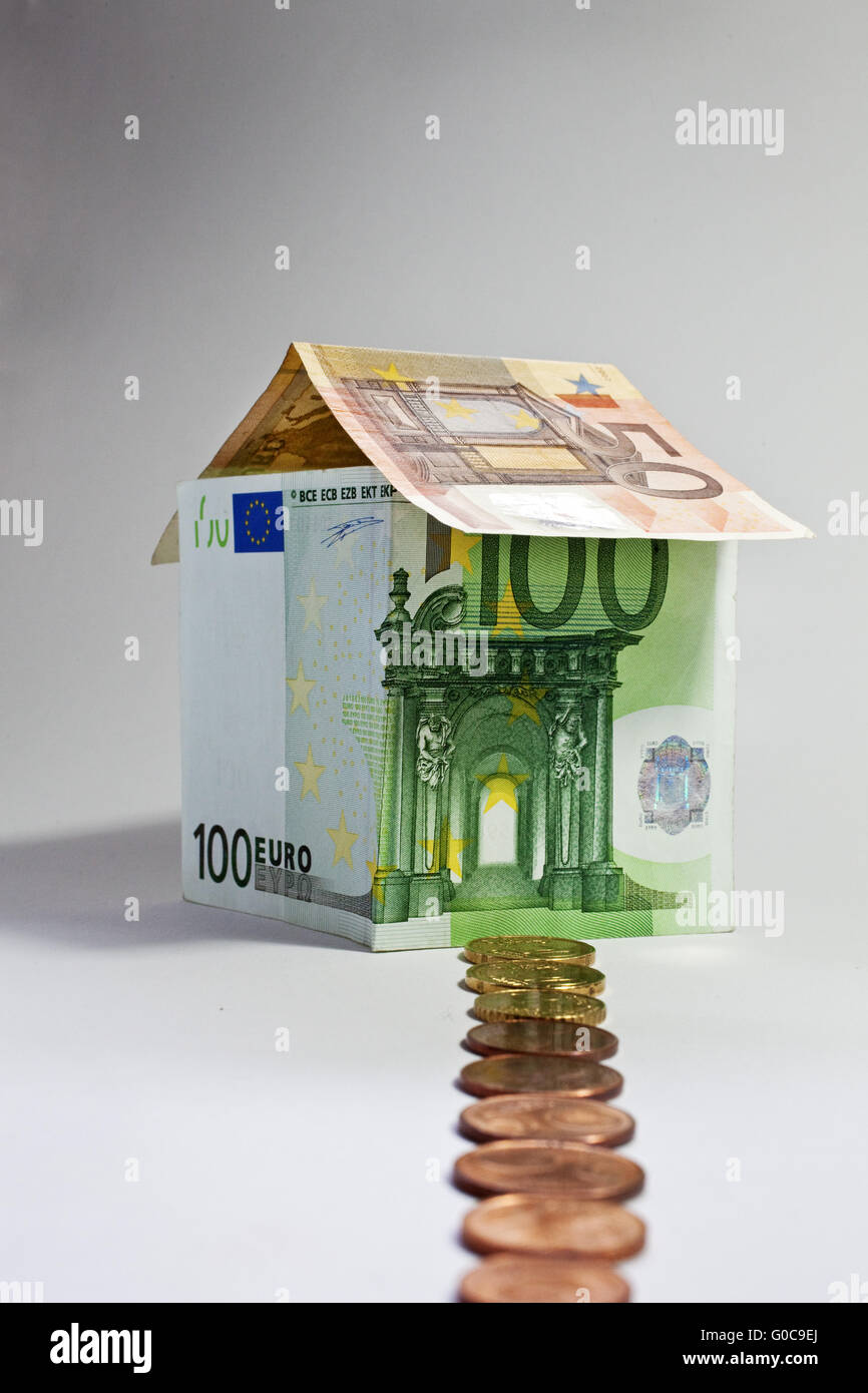 House made of euro banknotes, symbolic image - Stock Image