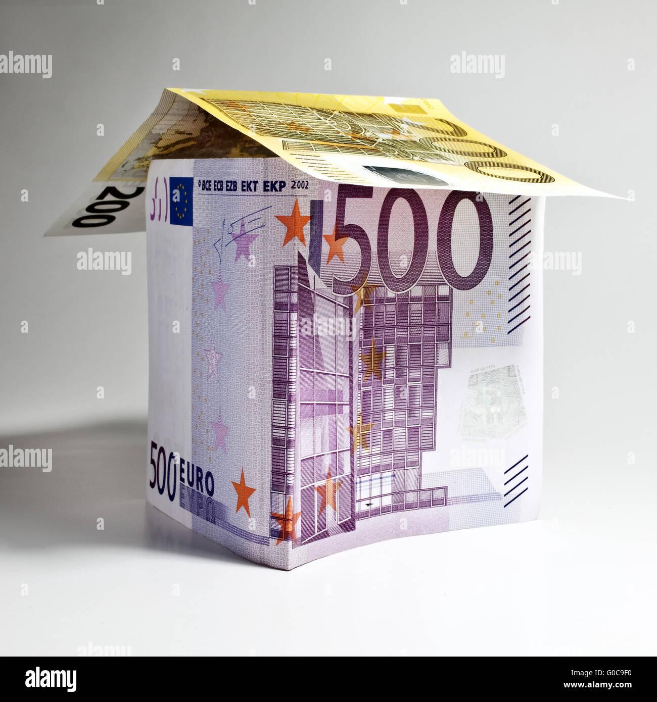 House made of euro banknotes, symbolic image - Stock Image
