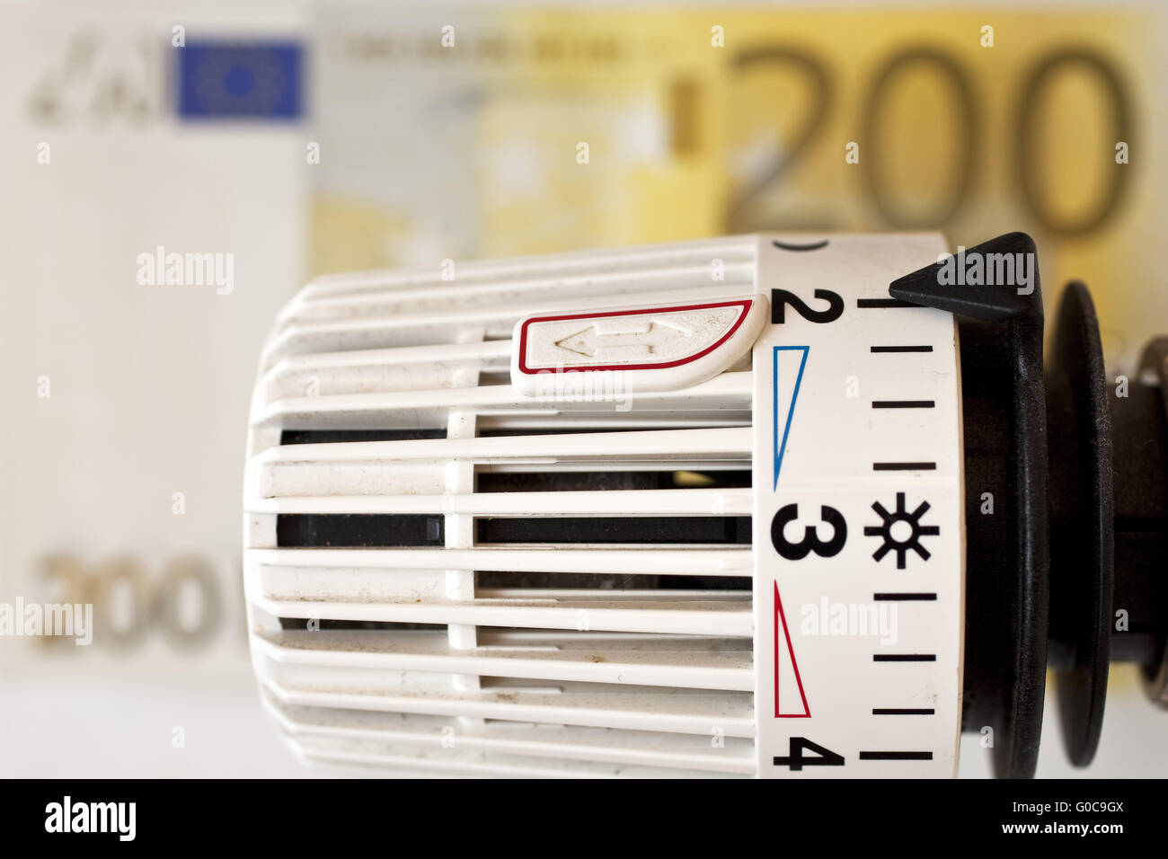 heating thermostat and Euro bills, heating coasts - Stock Image
