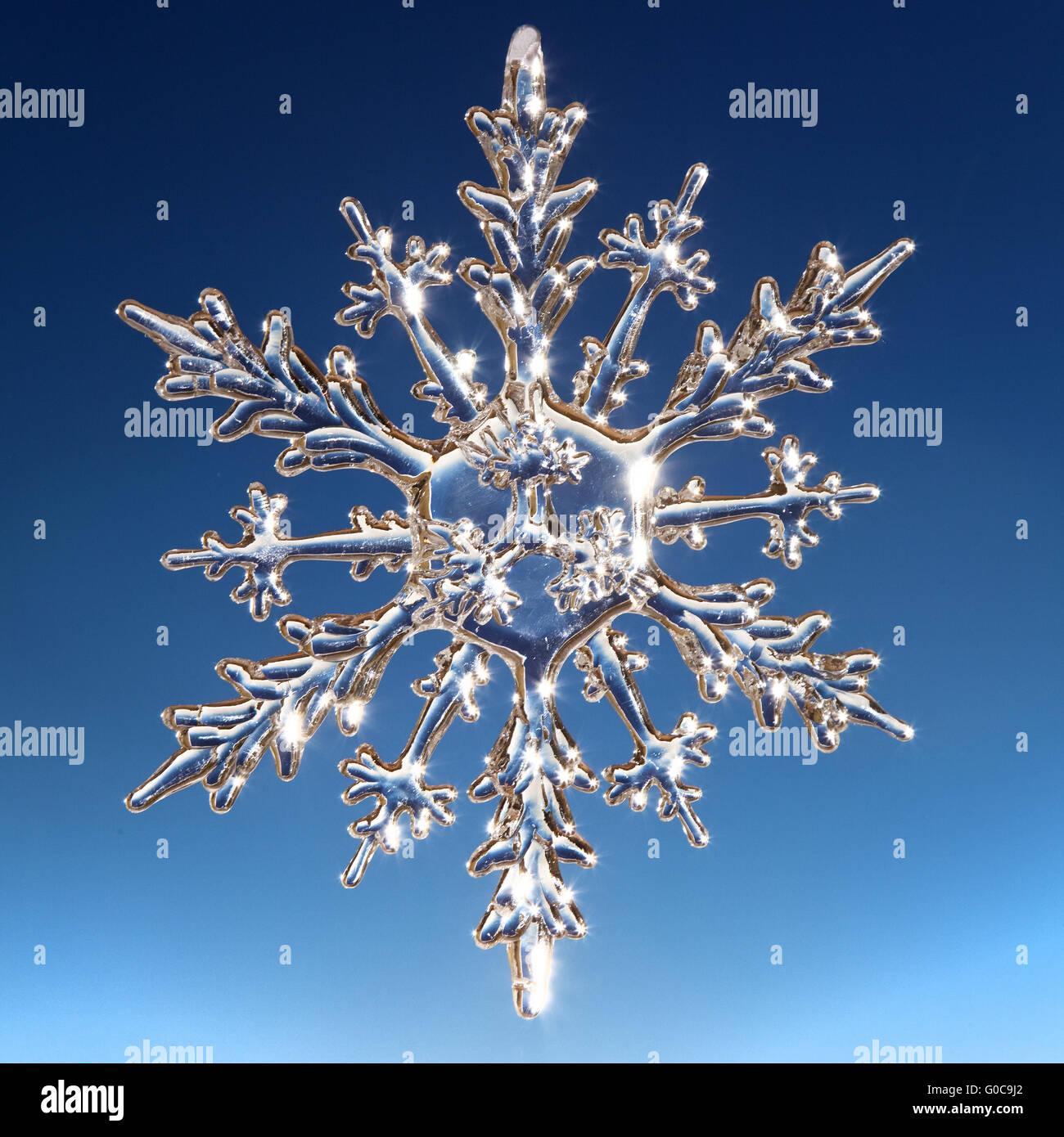 Christmas star as an ice crystal - Stock Image
