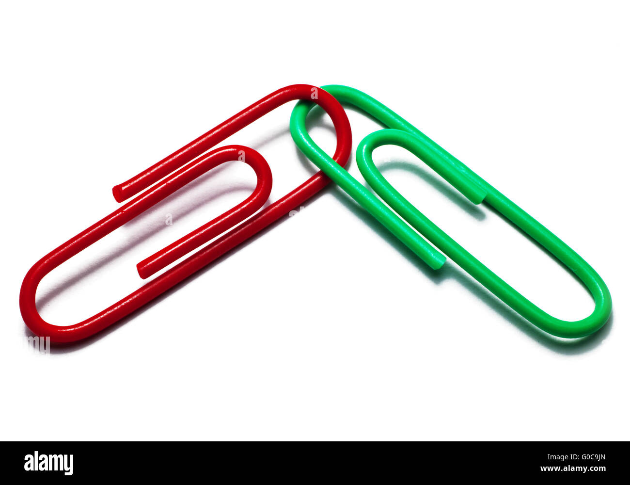 Red and green paper clips, symbolic image - Stock Image