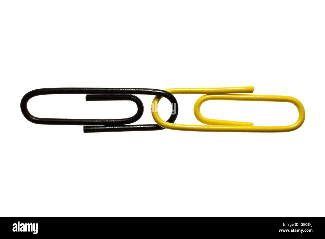 Black and yellow paper clips, symbolic image - Stock Image