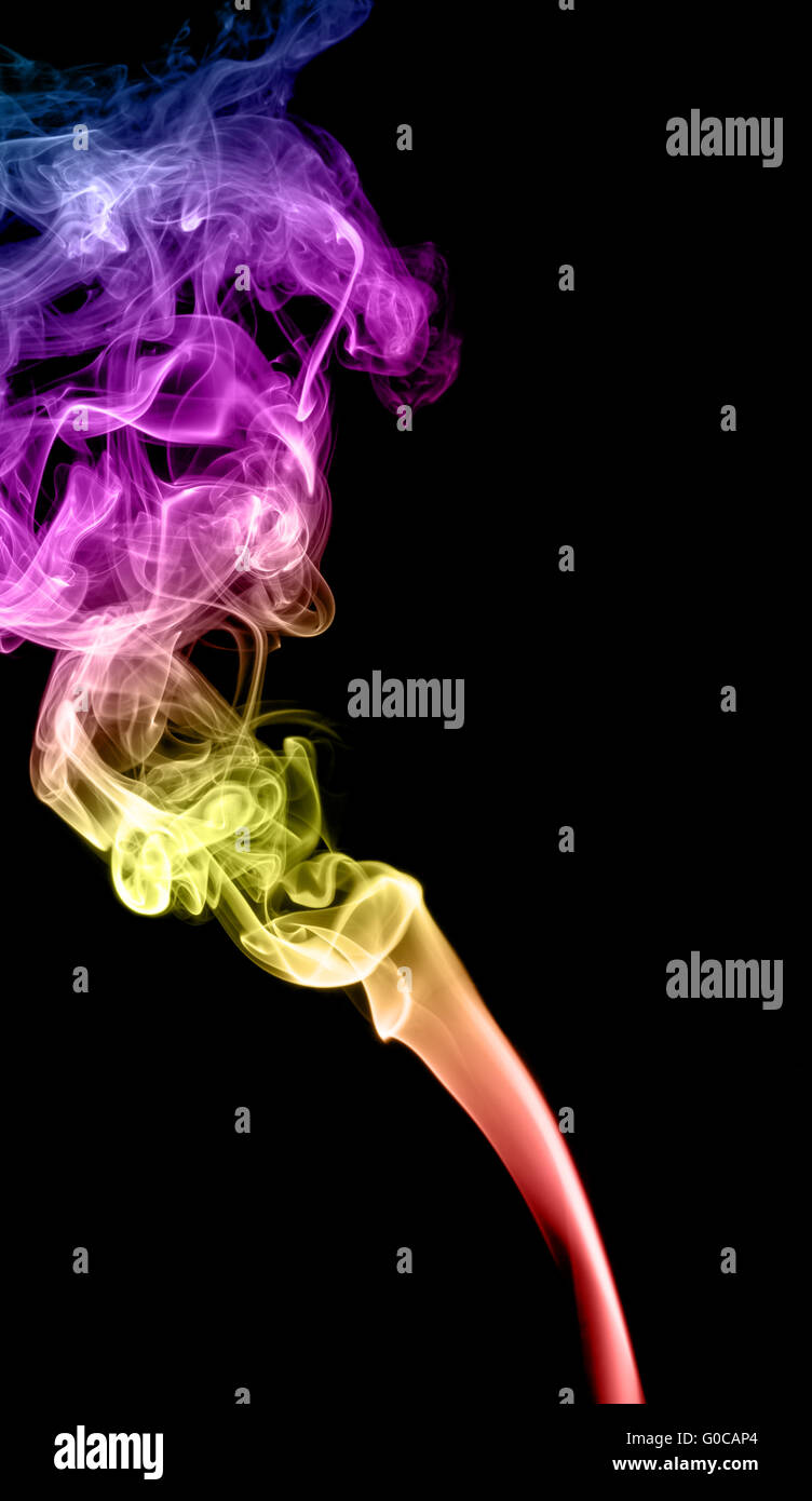 Abstract multicolored smoke on a dark background - Stock Image