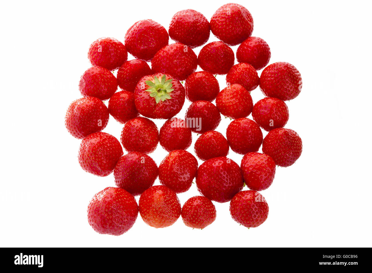 Big Strawberry Standing Out From The Crowd - Stock Image