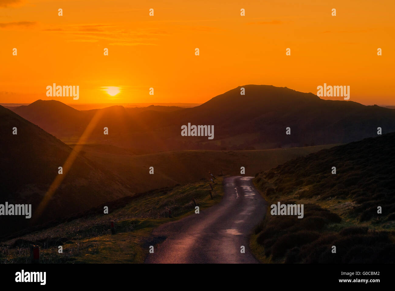 Sunrise over the Shropshire Hills AONB. Photo from Bur Way looking across Carding Mill Valley & Long Mynd above - Stock Image