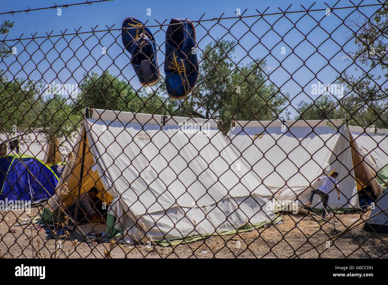 Refugee camp on the island of Lesvos with clothes drying and tents - Stock Image