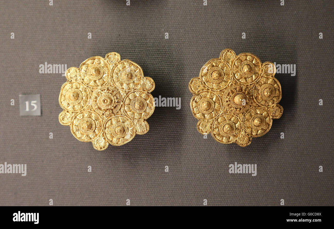 Earrings disc-shaped ears. 6th-7th century BC. Circles plant decoration and central dimple. Gold. Filigree and granulation. - Stock Image