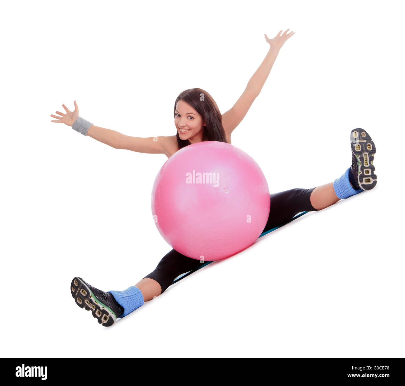 Attractive young female with fitness ball in stretching - Stock Image