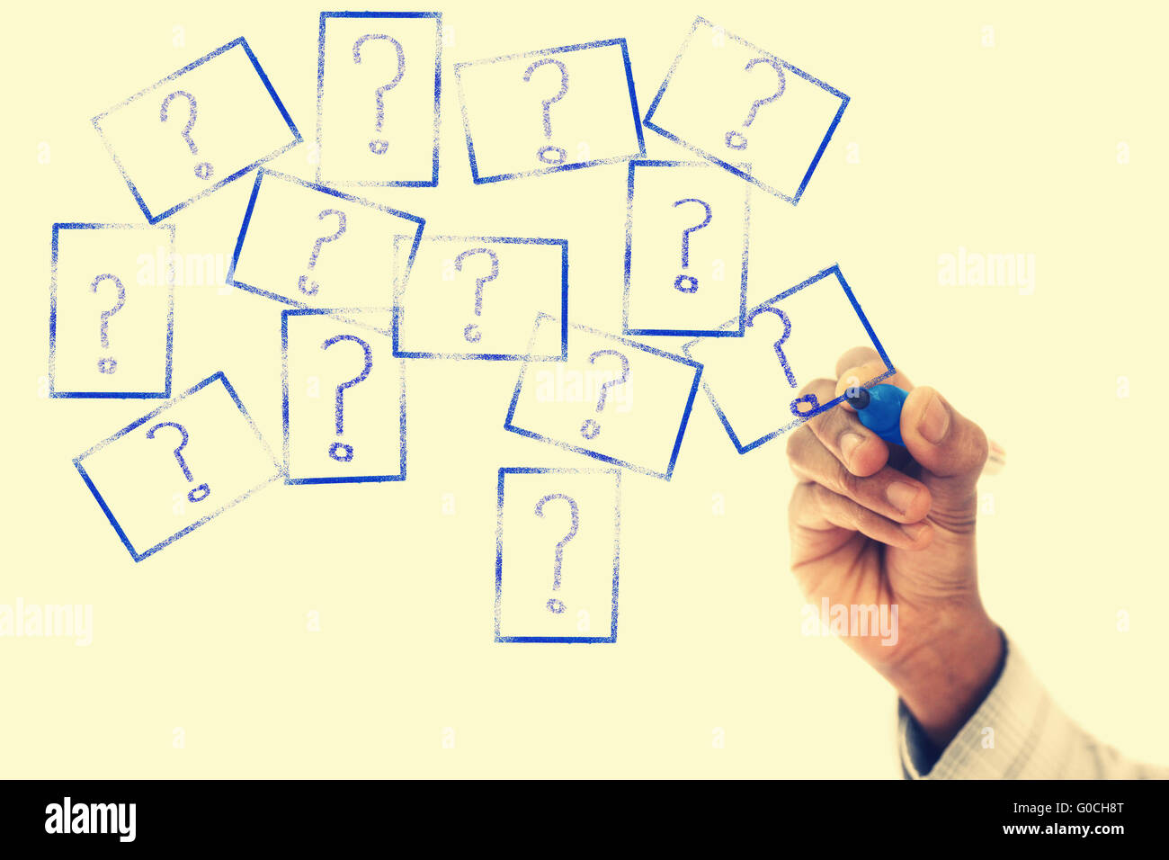 Many Question Marks are drawn on transparent wipe board - Stock Image