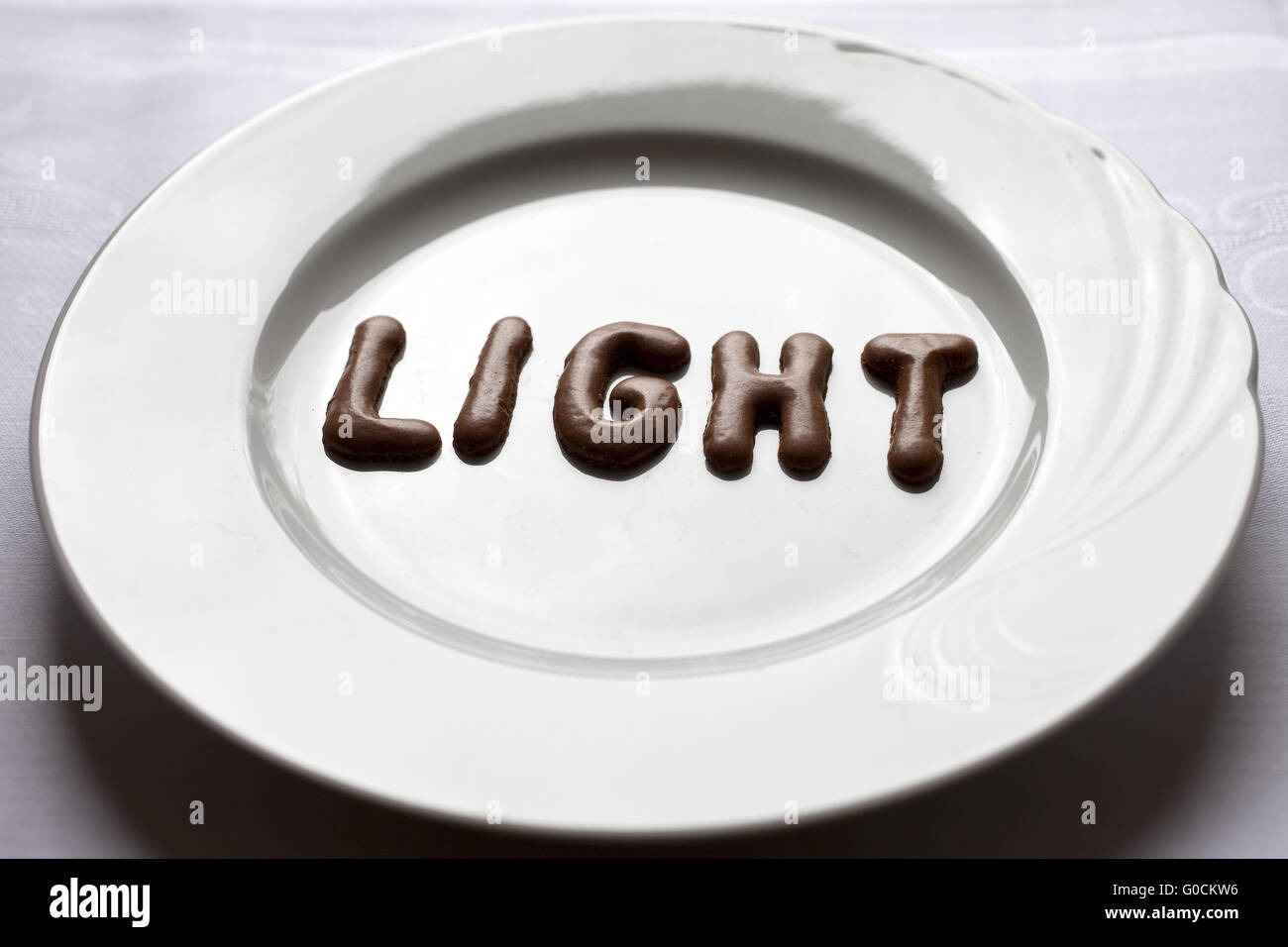 Letters forming the word light on a plate - Stock Image