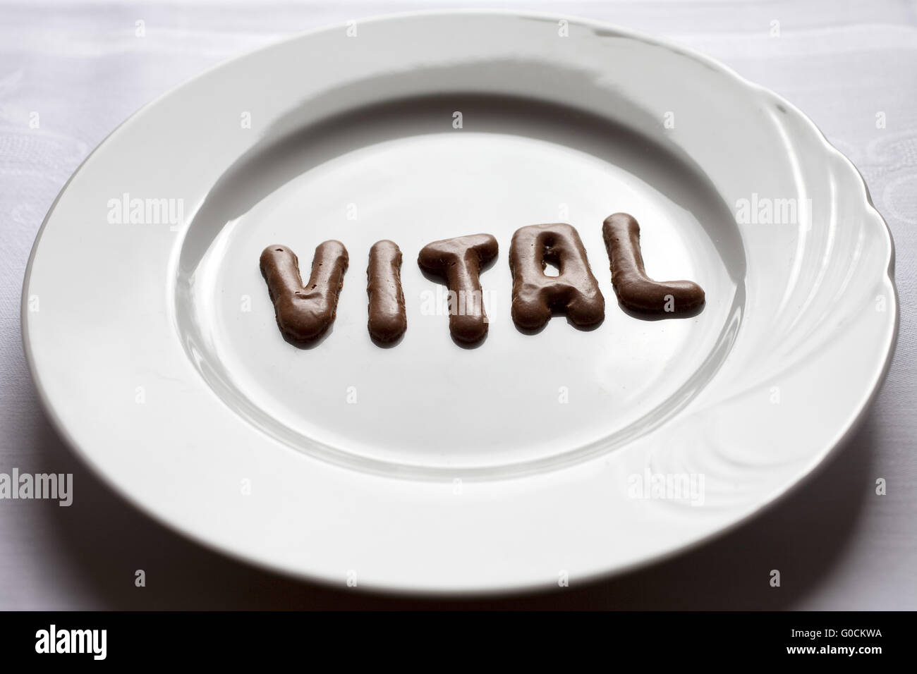 Letters forming the word vital on a plate - Stock Image
