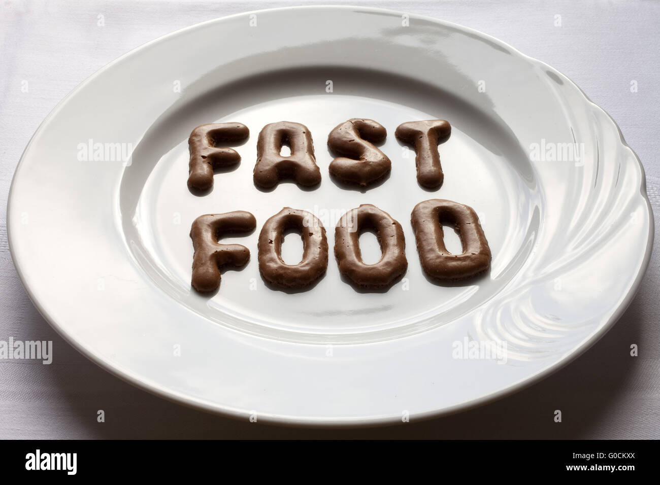 Letters forming the word fast food on a plate Stock Photo