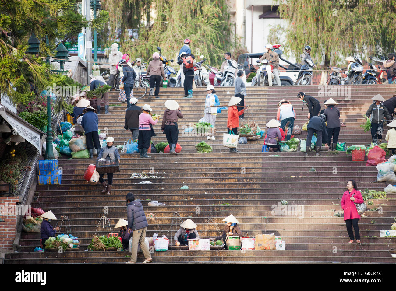 A local farmer and street vendors in sunday market in central city of Da Lat town. - Stock Image