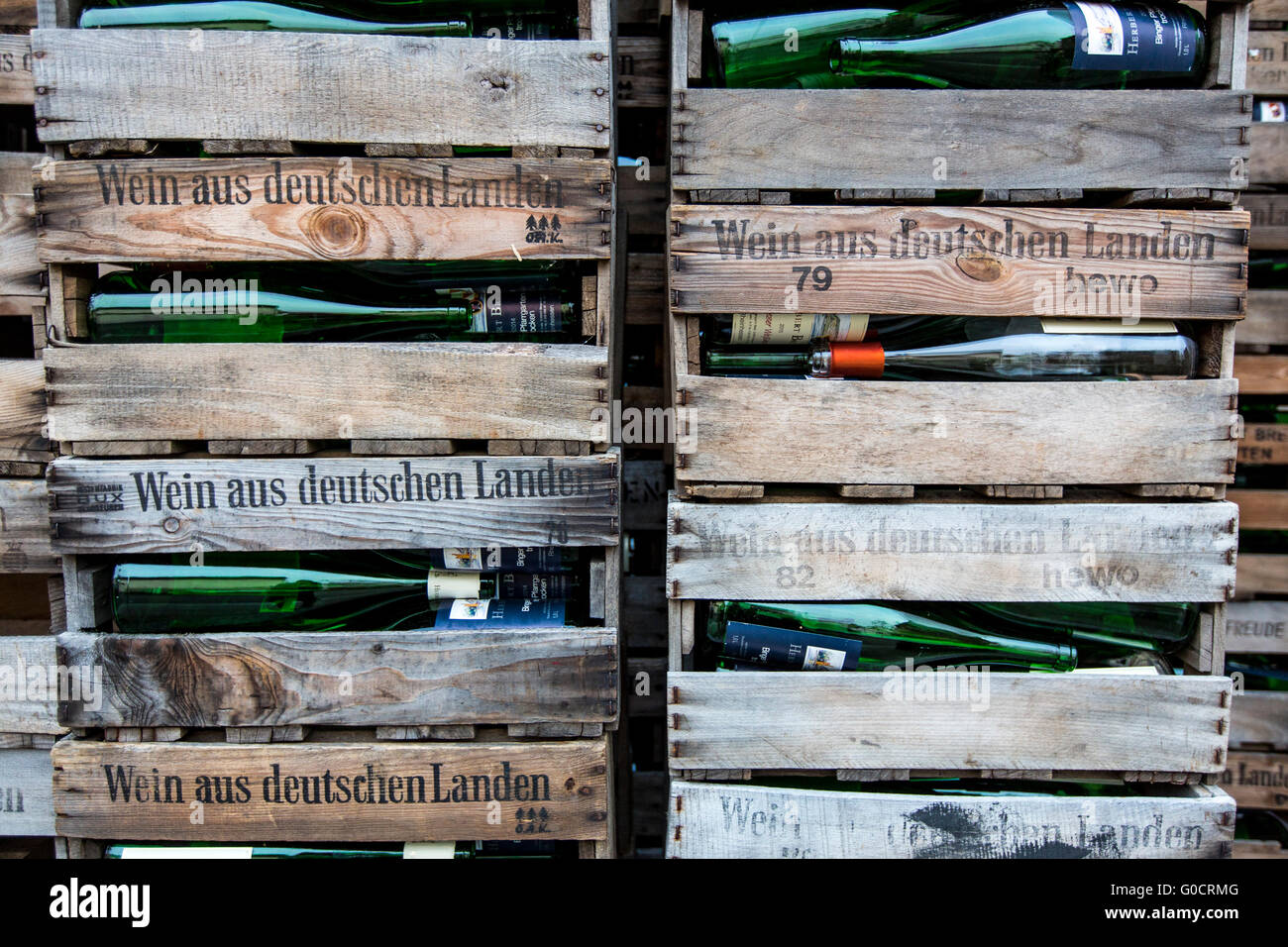 Wooden wine boxes, filled with empty wine bottles, branded with wine from Germany, Stock Photo