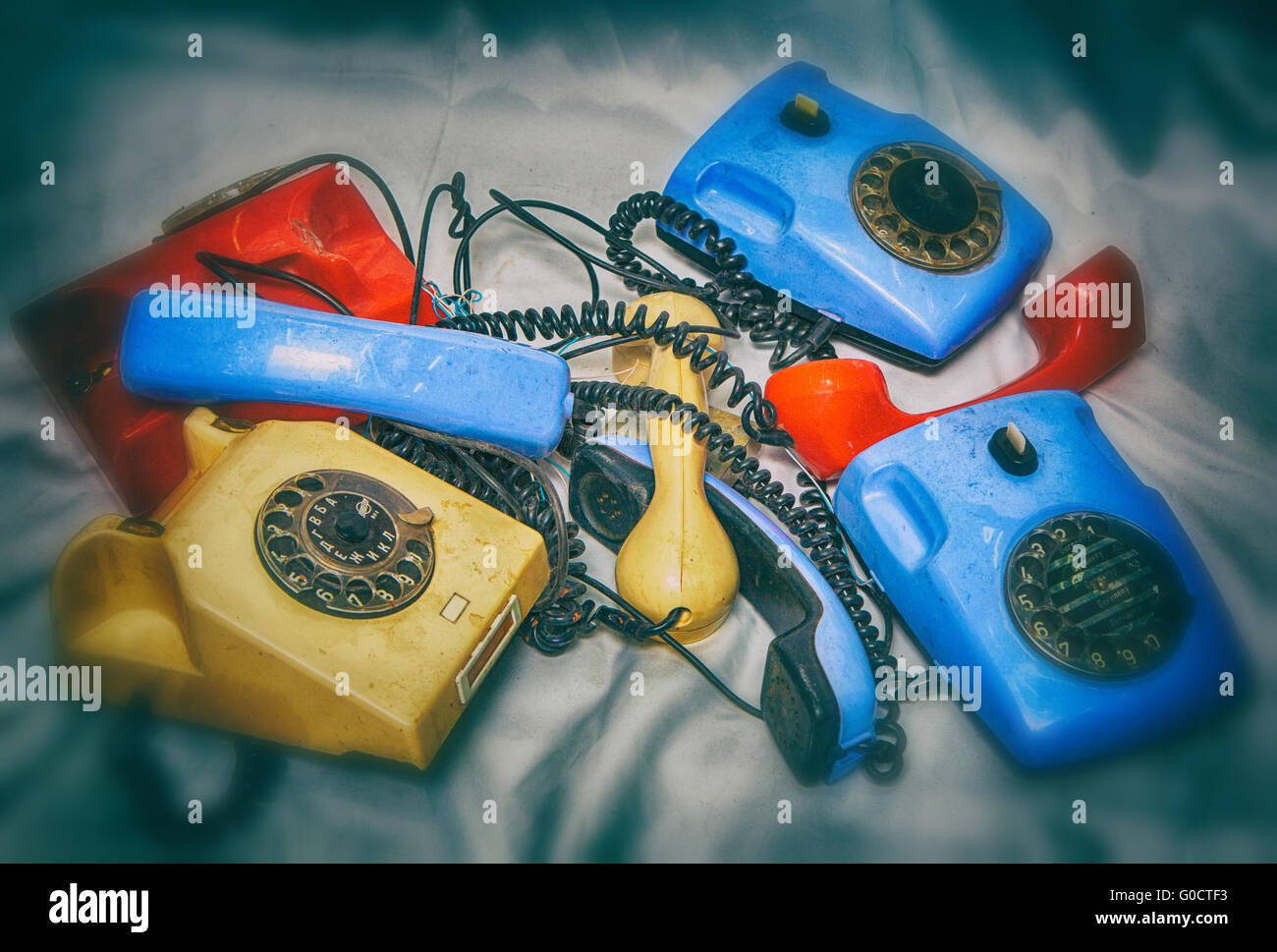 old broken phones, photo in old style image. - Stock Image
