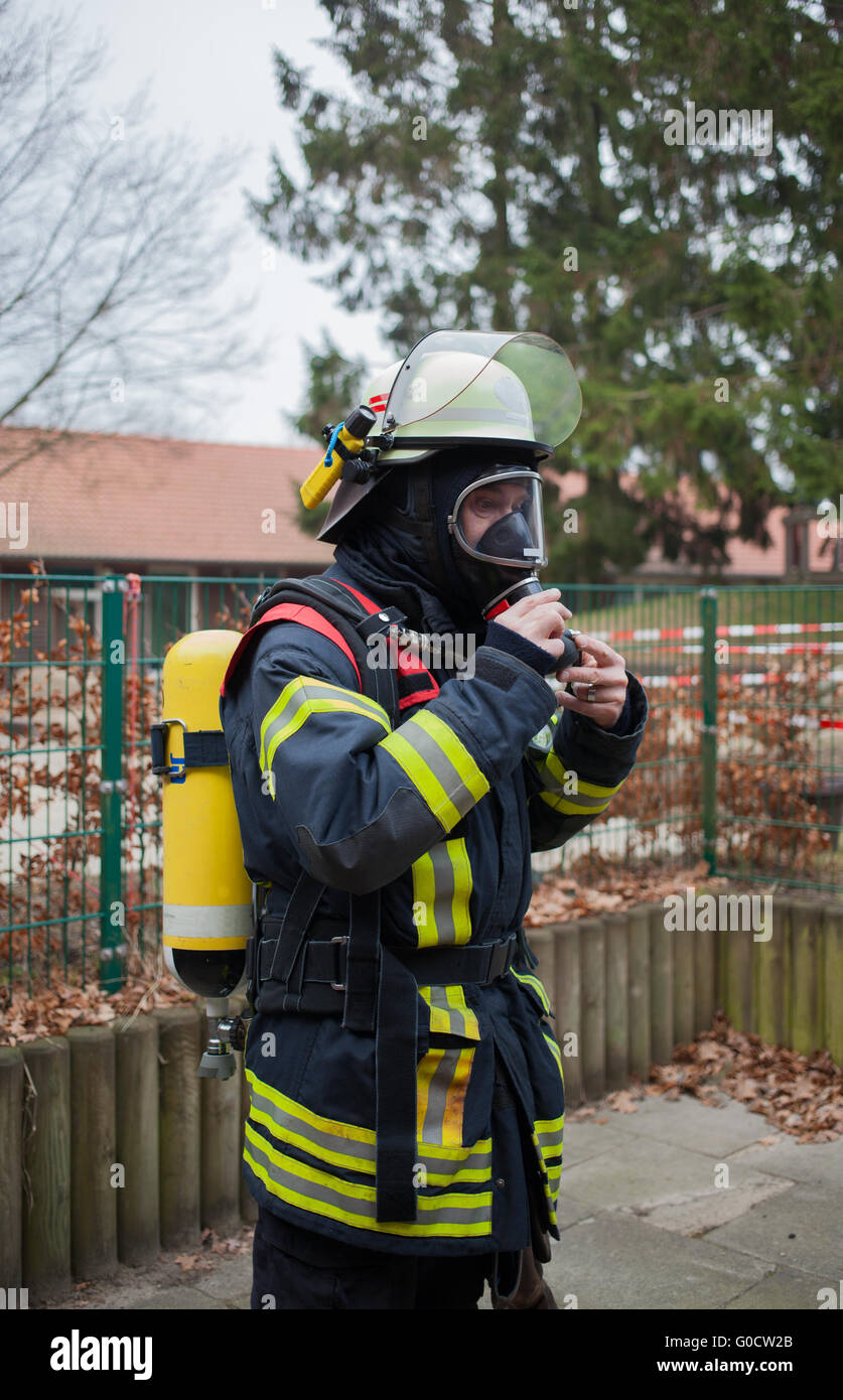 Firefighter creates his respiratory protective equ - Stock Image