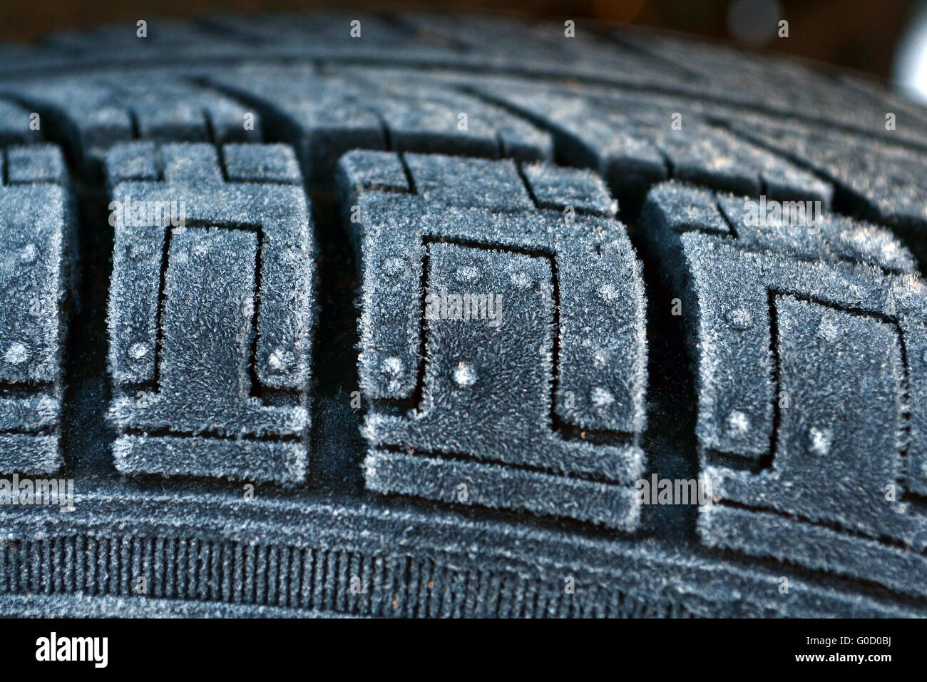 The tire is covered with frost. - Stock Image