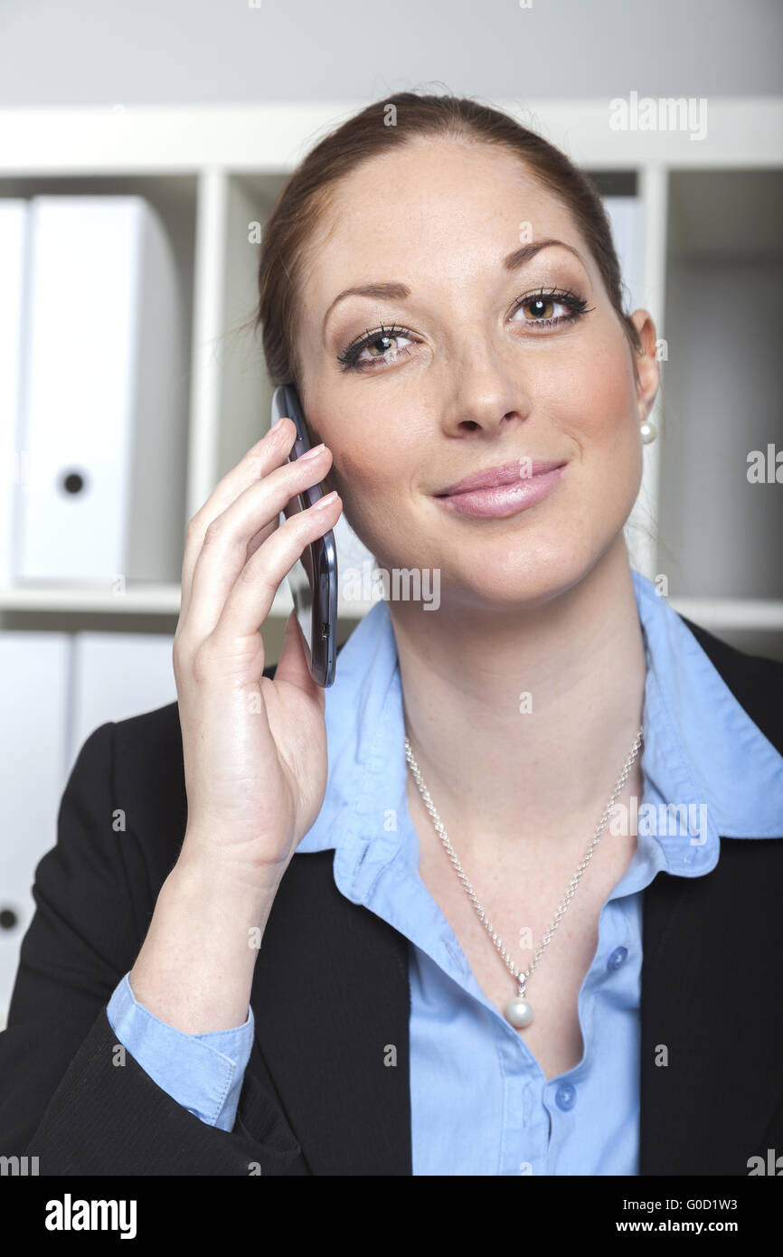businesswoman with cell phone - Stock Image