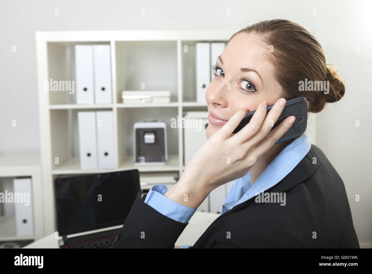 Businesswoman has a call - Stock Image