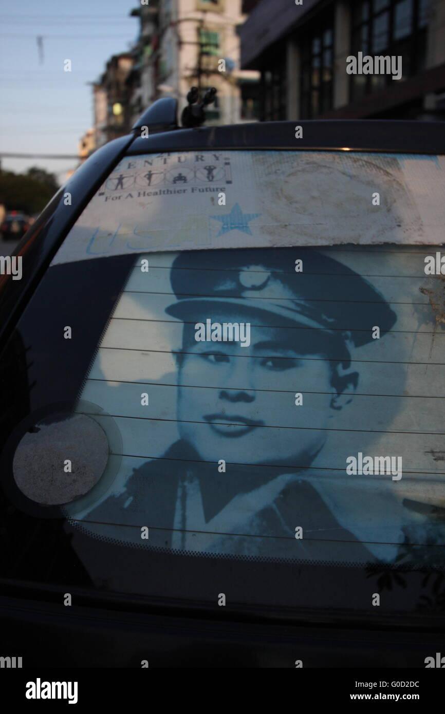 A photograph of Aung San, founder of modern Burma and father of Aung San Suu Kyi, in a car window in Yangon, Burma. - Stock Image