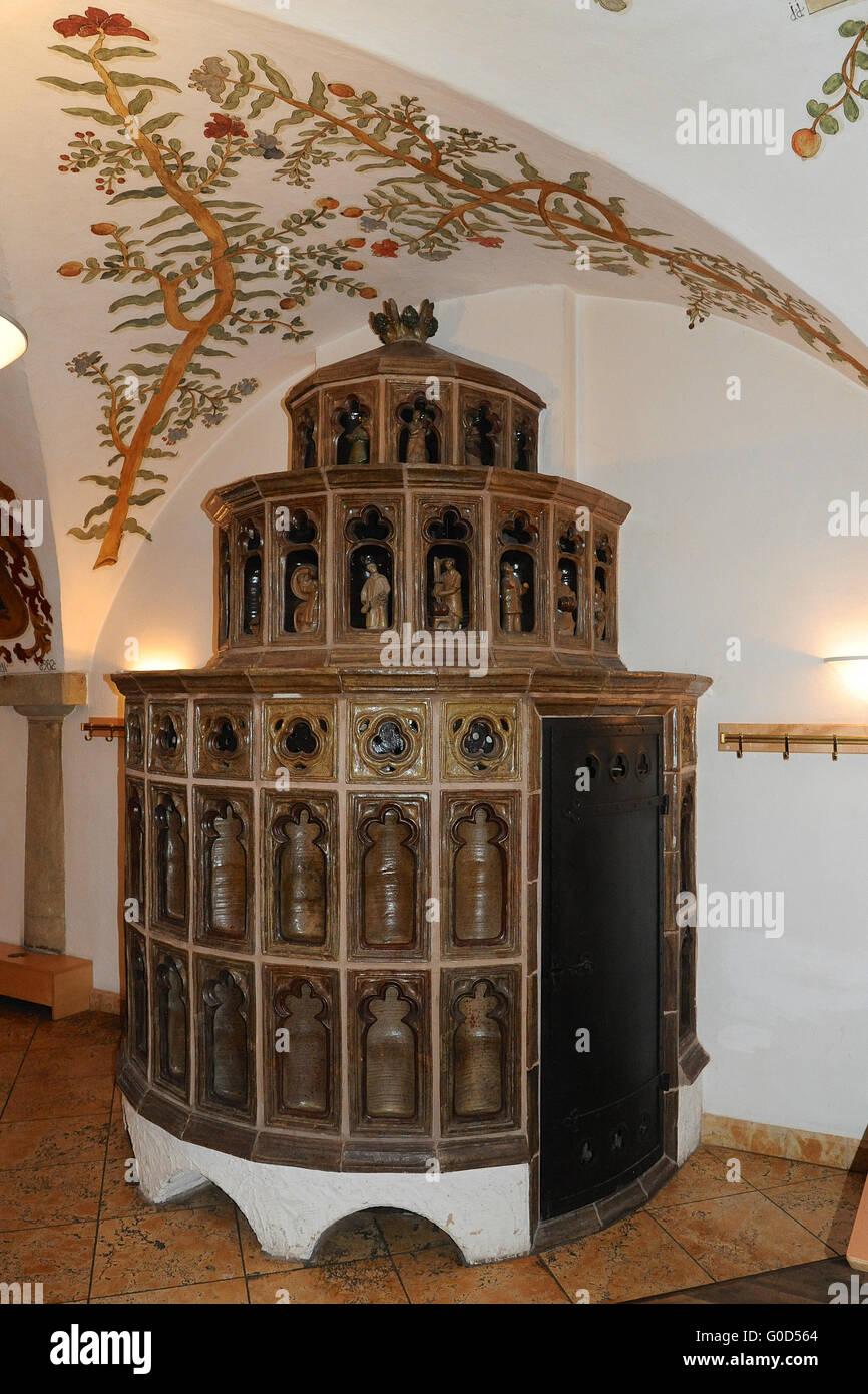 Tiled stove in Bavaria germany - Stock Image