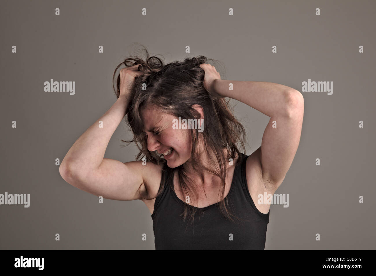 Young woman is in despair Stock Photo