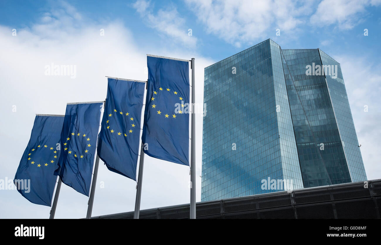 Flags in front of very new building of european ce - Stock Image