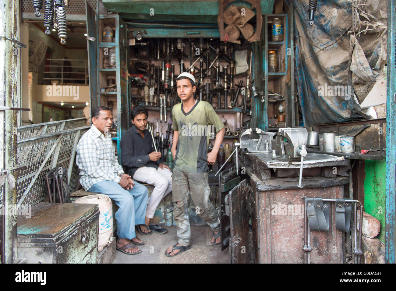 Unidentified local Indian mechanic pose for camera the street of Old Delhi in India. - Stock Image