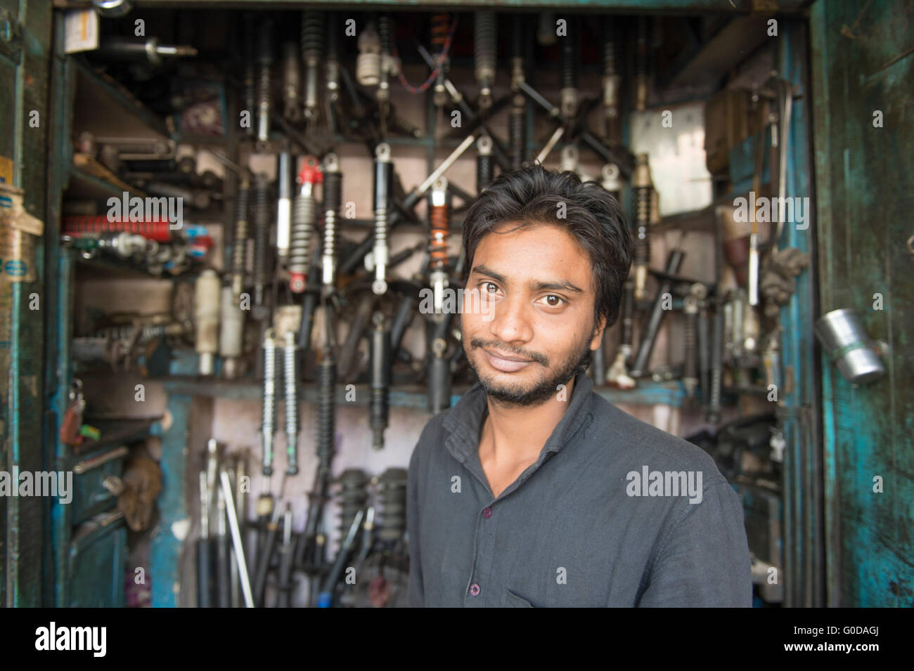 Local Indian mechanic pose for camera the street of Old Delhi in India. - Stock Image
