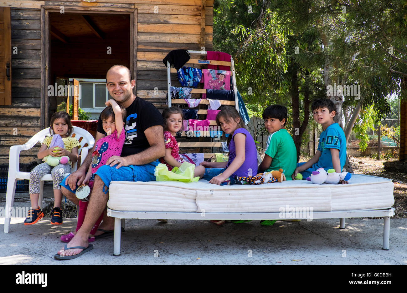 Syrian refugee father and six children given shelter in a refugee camp on the island of Lesvos after crossing from - Stock Image