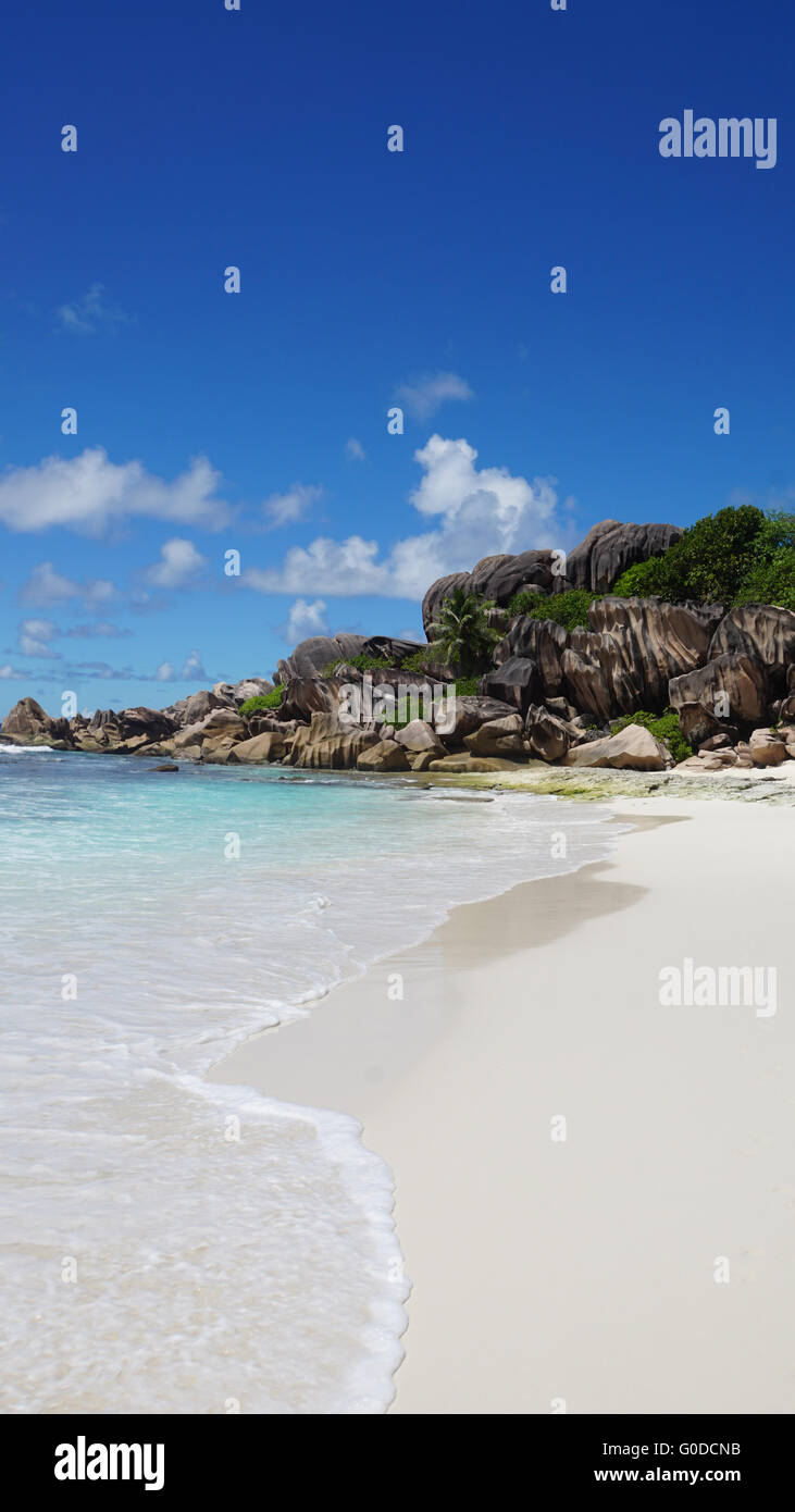 amazing summer day at tropical beach on la digue - Stock Image