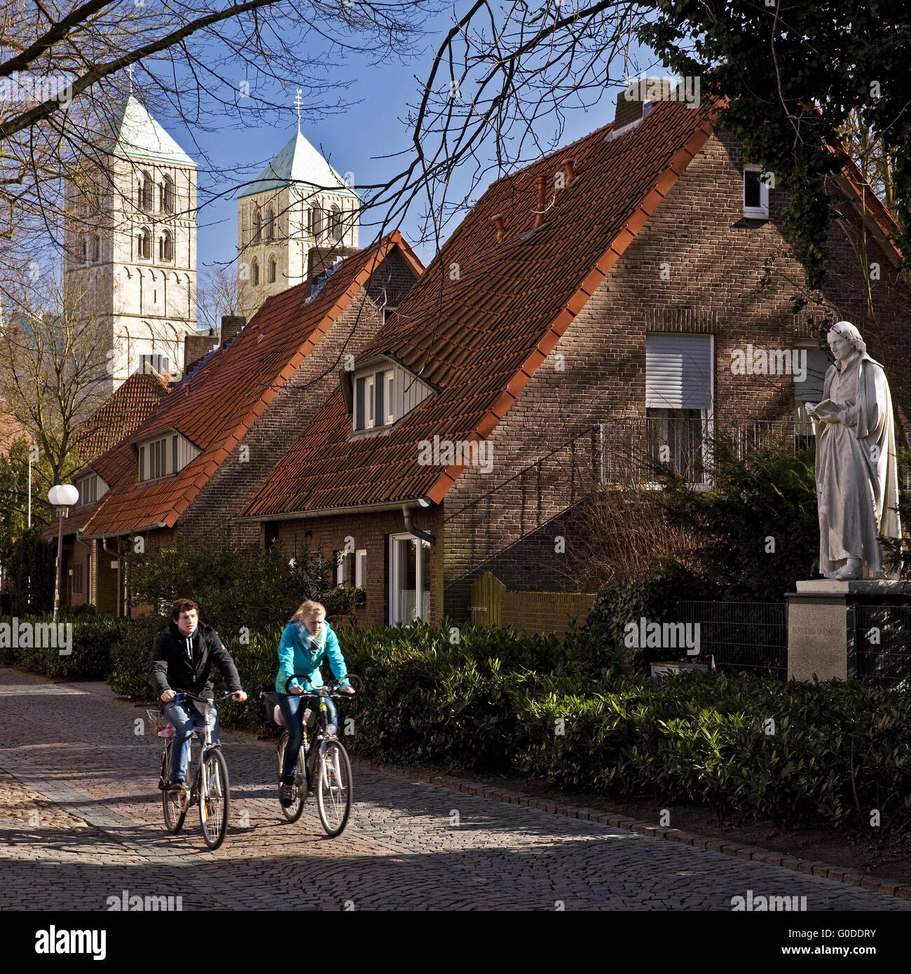 Cyclists with the St - Paul's Cathedral, Muenster - Stock Image