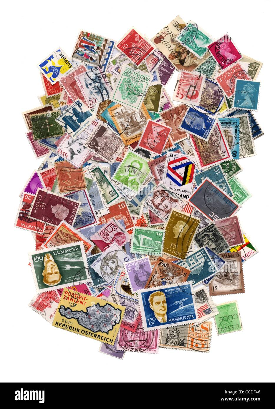 Hundreds of postage stamps from many different countries - Stock Image