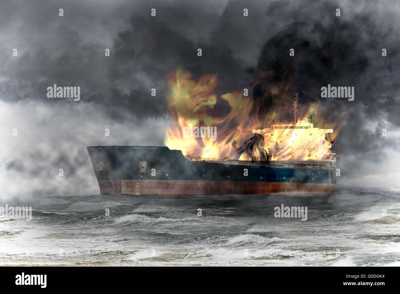 Burning tanker ship on sea at storm. Stock Photo