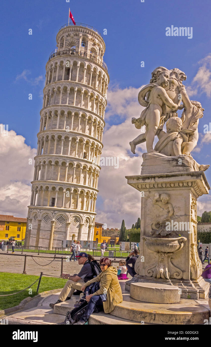 The Leaning Tower and statue of Putti Pisa Tuscany - Stock Image