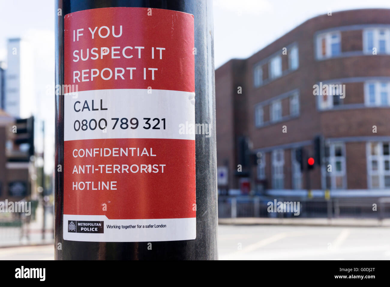 A sign publicising the confidential anti-terrorist hotline. - Stock Image