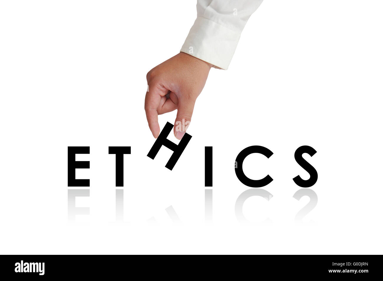 Gesture of hand picking up letters and making Ethics word isolated on white - Stock Image