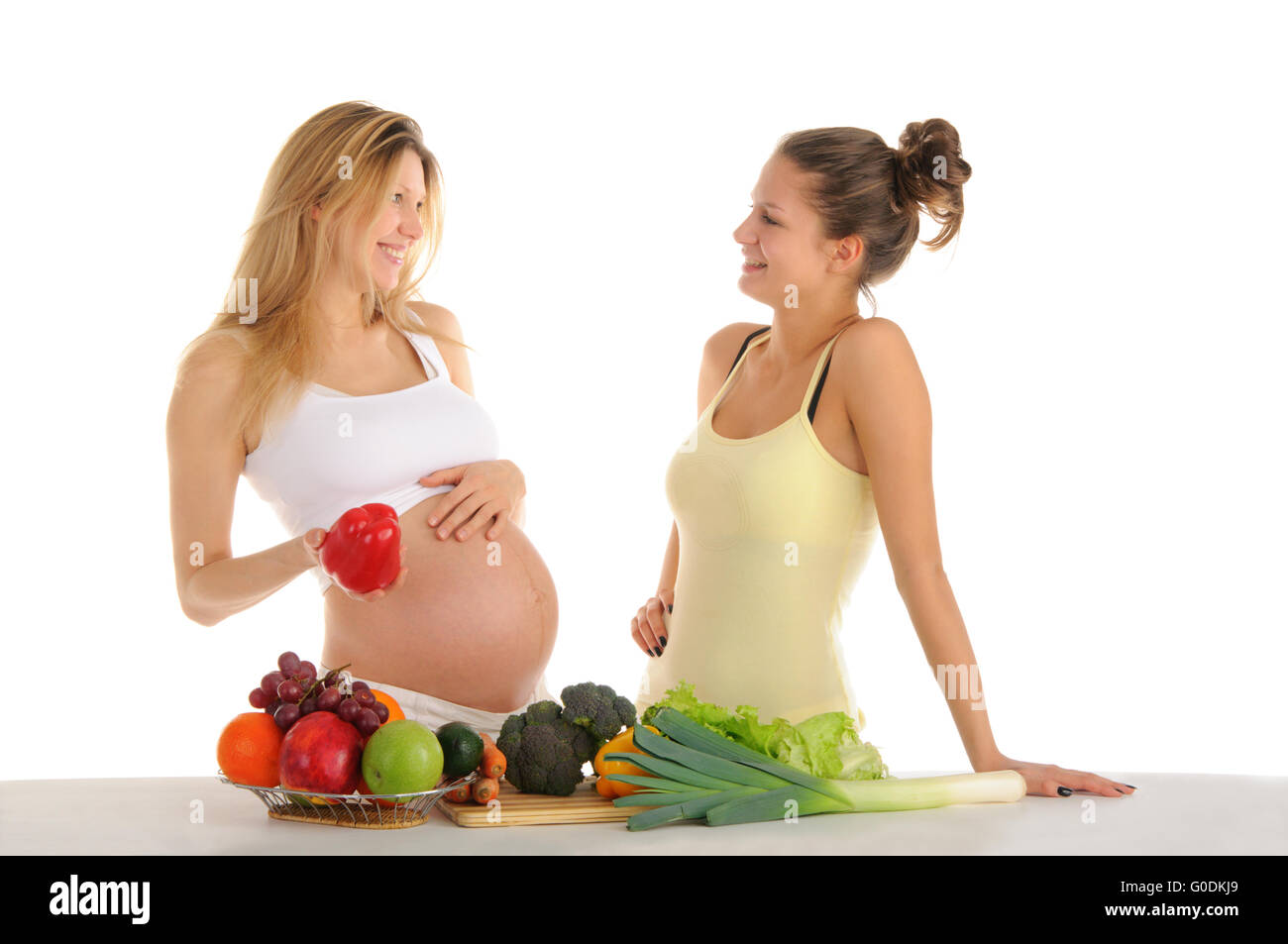 Two gay girlfriends with fruits and vegetables - Stock Image