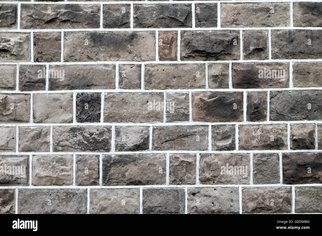 Background from an old brown stone wall - Stock Image