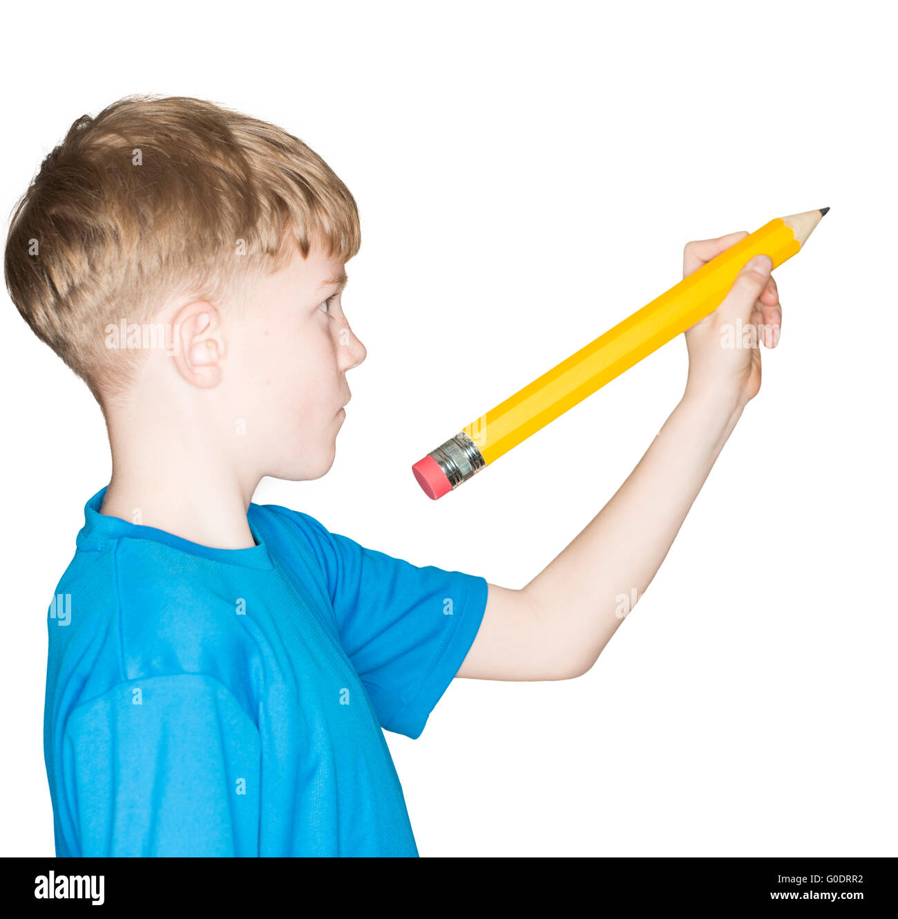 child with a pencil in hand - Stock Image