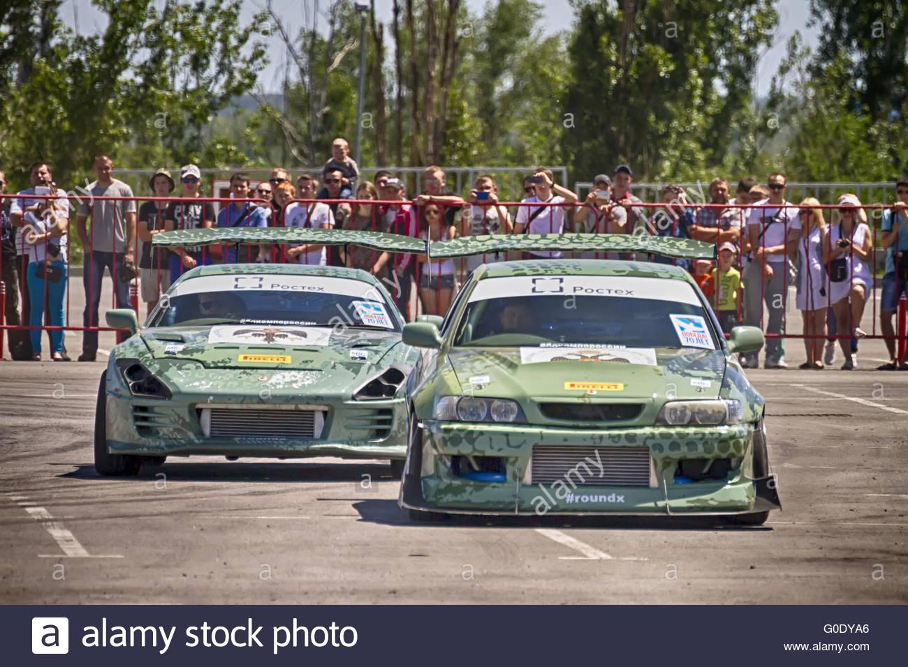 Drift cars team Round-X go near a short distance - Stock Image