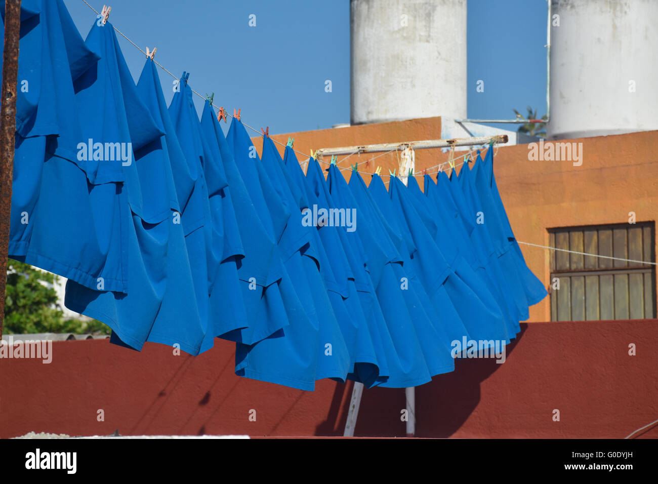 Blue laundry tablecloths on clothesline - Stock Image