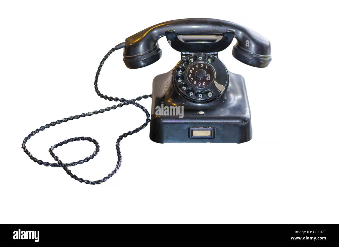 Antique Telephone with dial on white background - Stock Image