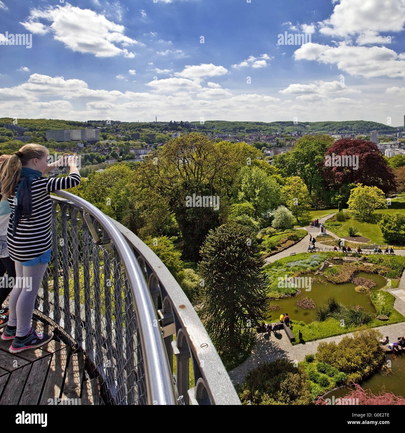 girl takes a photo of the Elisen Tower, Wuppertal - Stock Image