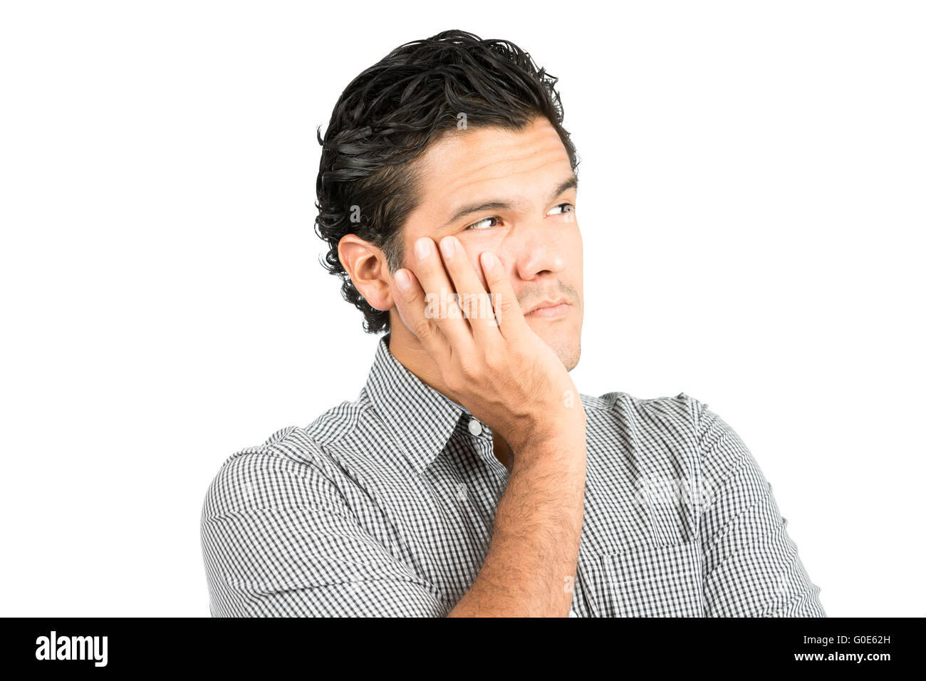Worried Serious Thoughts Latino Man Head In Hand - Stock Image