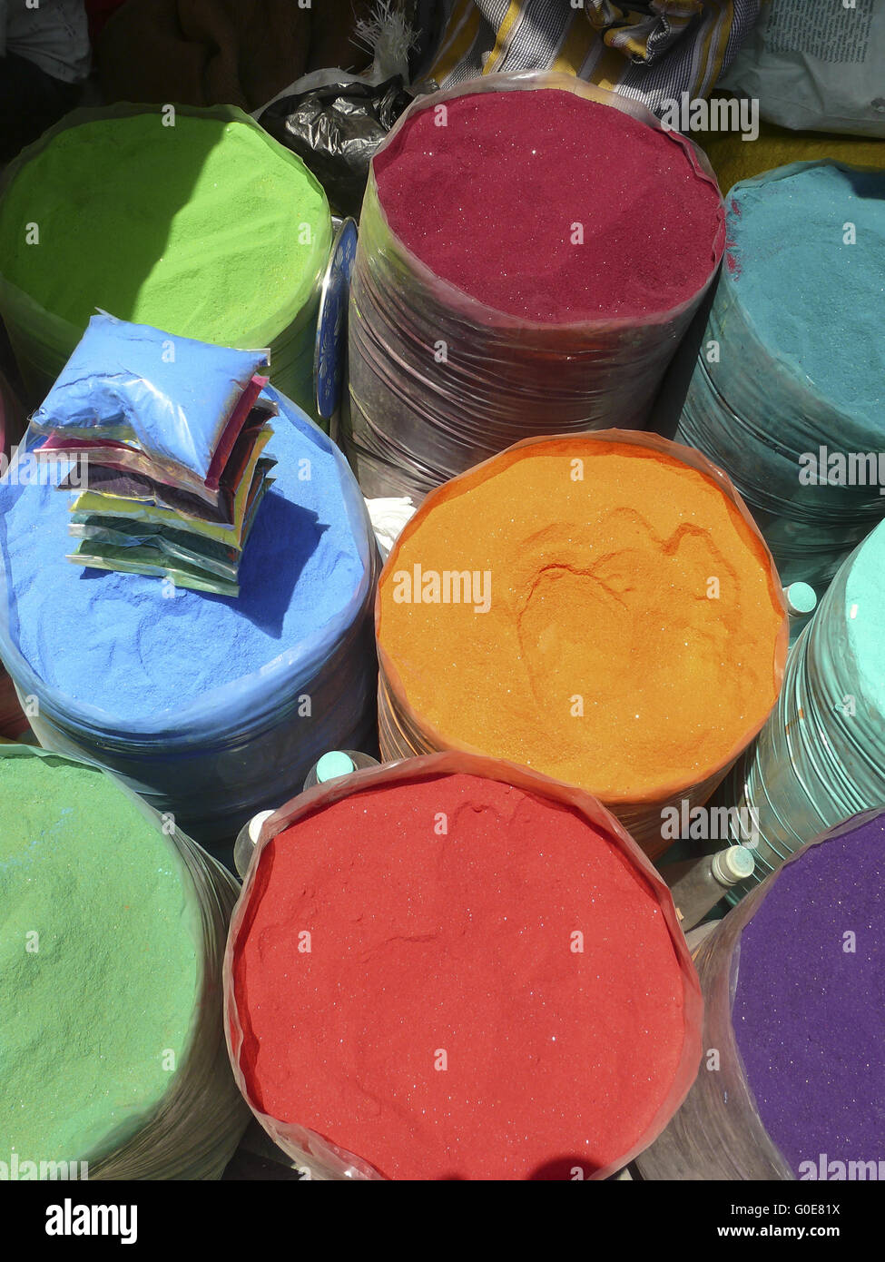 Colorful Rangoli for sell at marketplace, India - Stock Image
