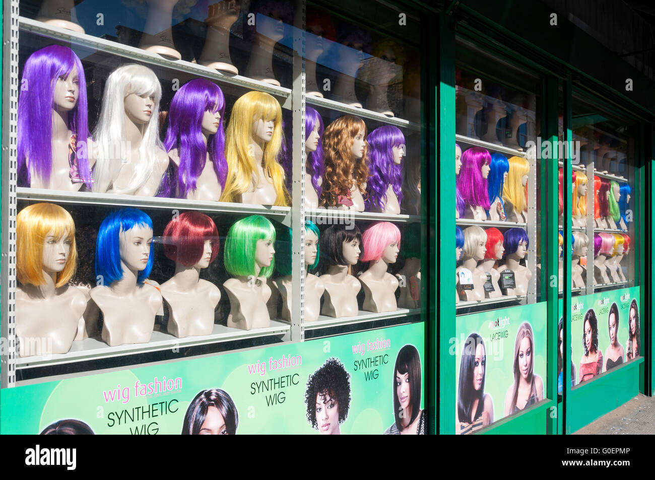 Synthetic wig shop window, Woodstock Road, Finsbury Park, London Borough of Haringey, Greater London, England, United - Stock Image