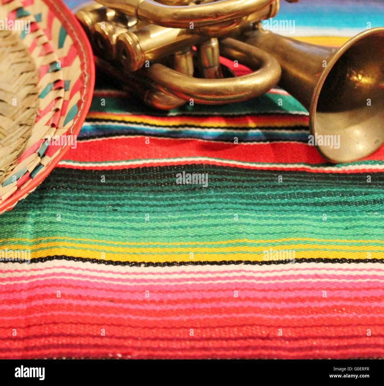 sombrero trumpet poncho background - Stock Image