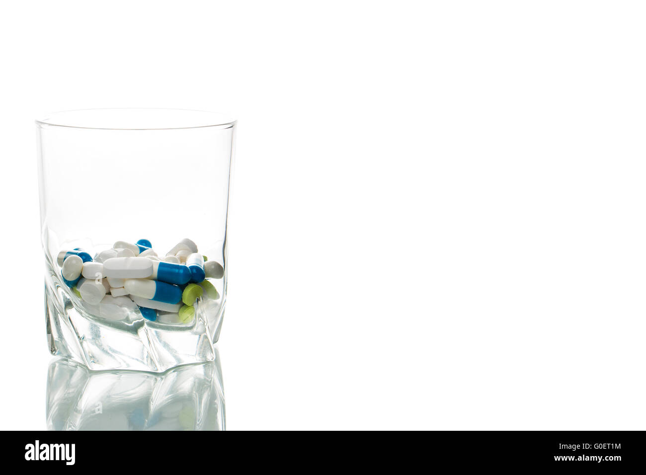 Tablets in a glass - Stock Image