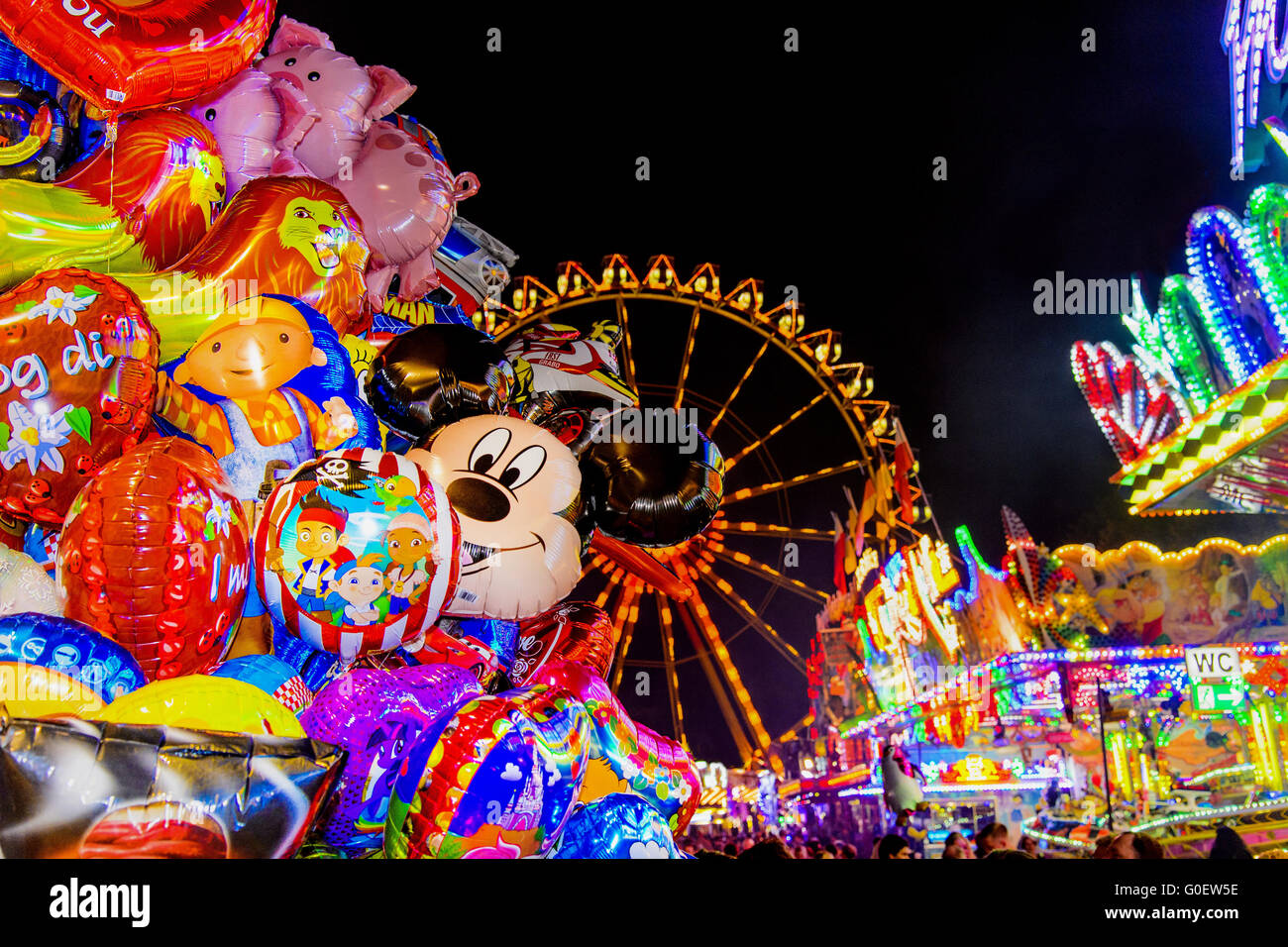 at the wiesn, Ferris wheel by night - Stock Image